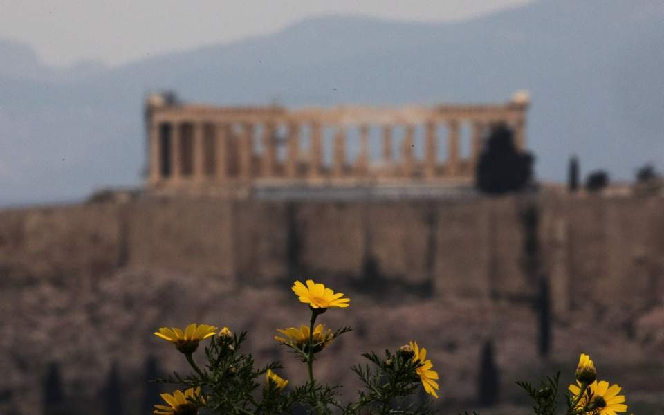 Parthenon in Athens, Greece, with spring flowers blooming.